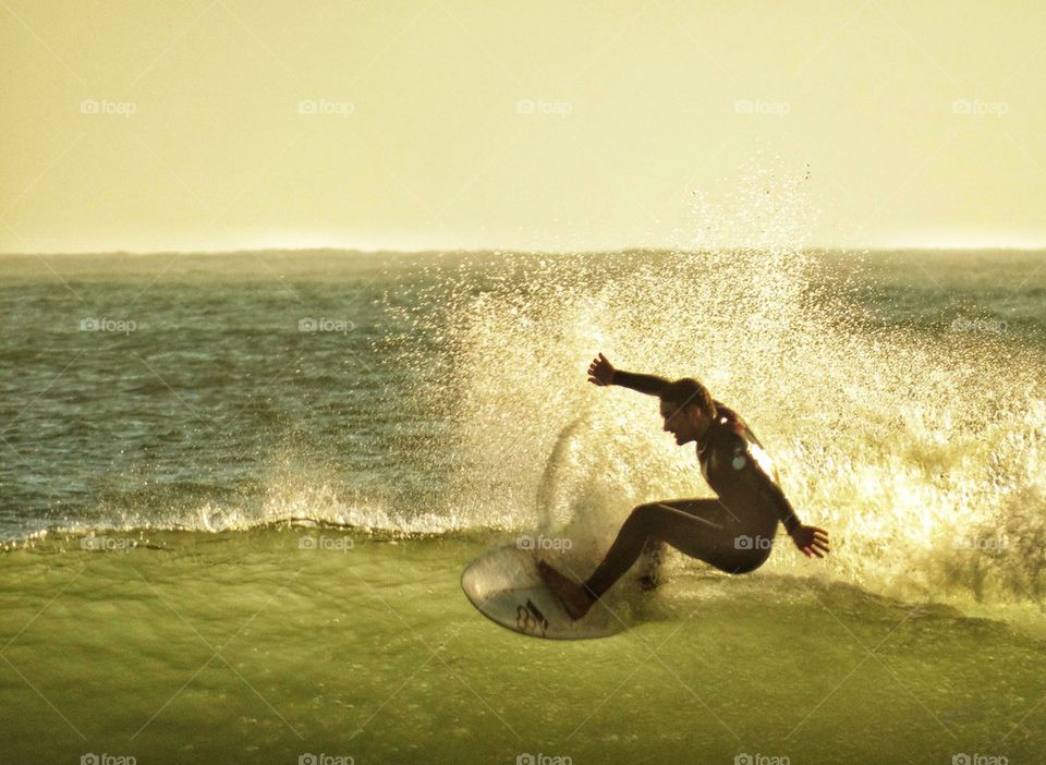 Surfer Challenging A Wave. California Surfing