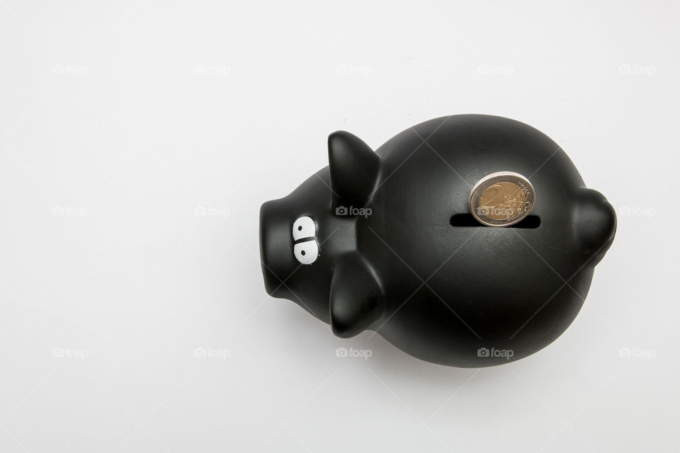 Black Piggy Bank With Coin, Isolated In White Backgound