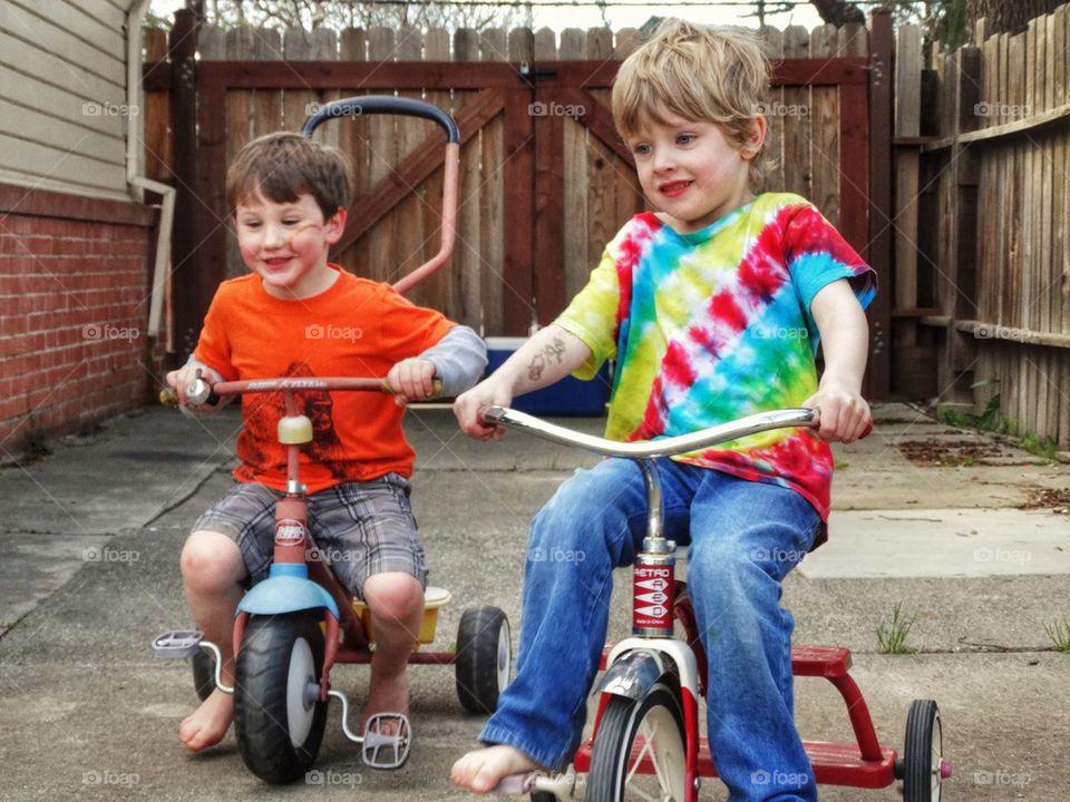 Young Boys Riding Trikes