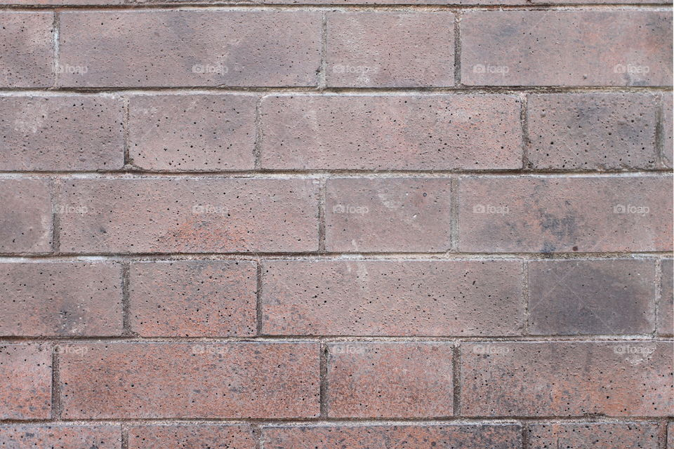 Brick Wall Red bricks wall with a regular pattern as a background