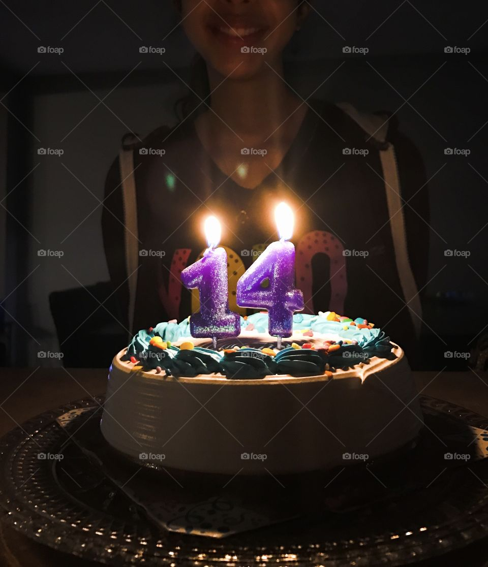 Teen ages 14th birthday candles and cake