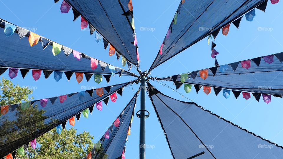 Colorful overhead fabric decoration in summer festival