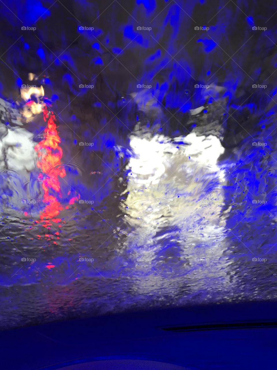 Red and Blue lights at car wash