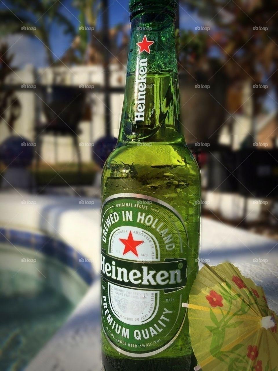 Heineken long exposure with mini yellow umbrella by pool
