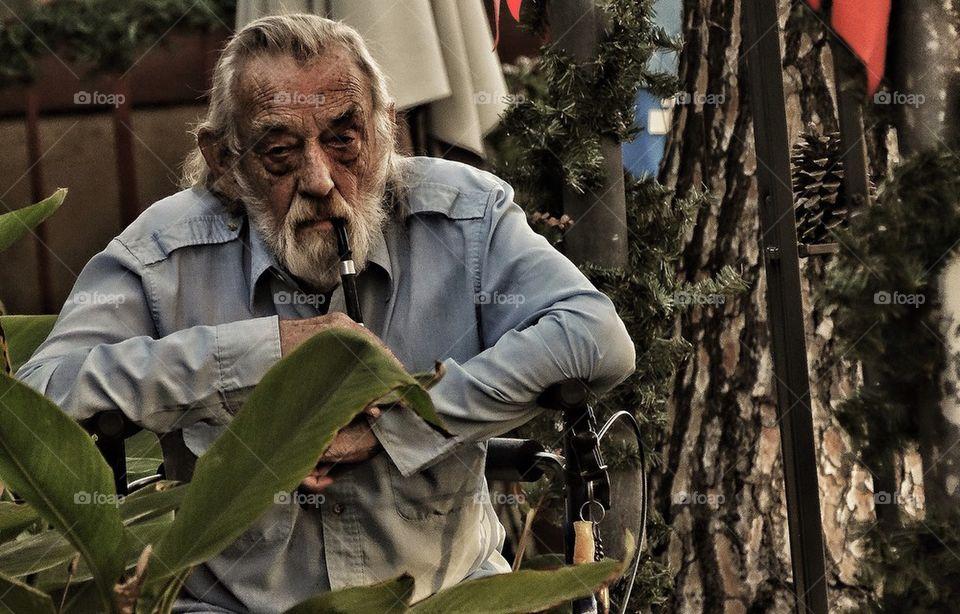 Wise old man smoking a pipe