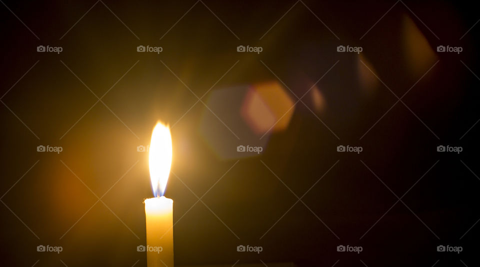 Close-up of single candle