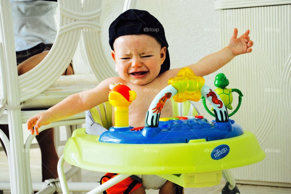 Crying baby in walker