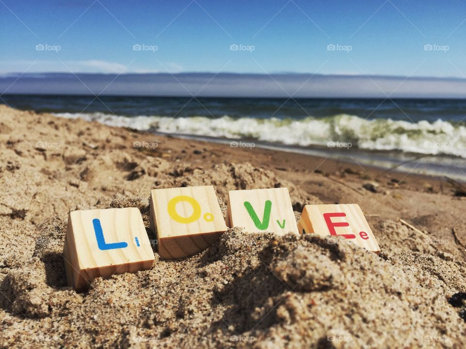 Love text at beach