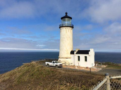 Lighthouse against blue sea