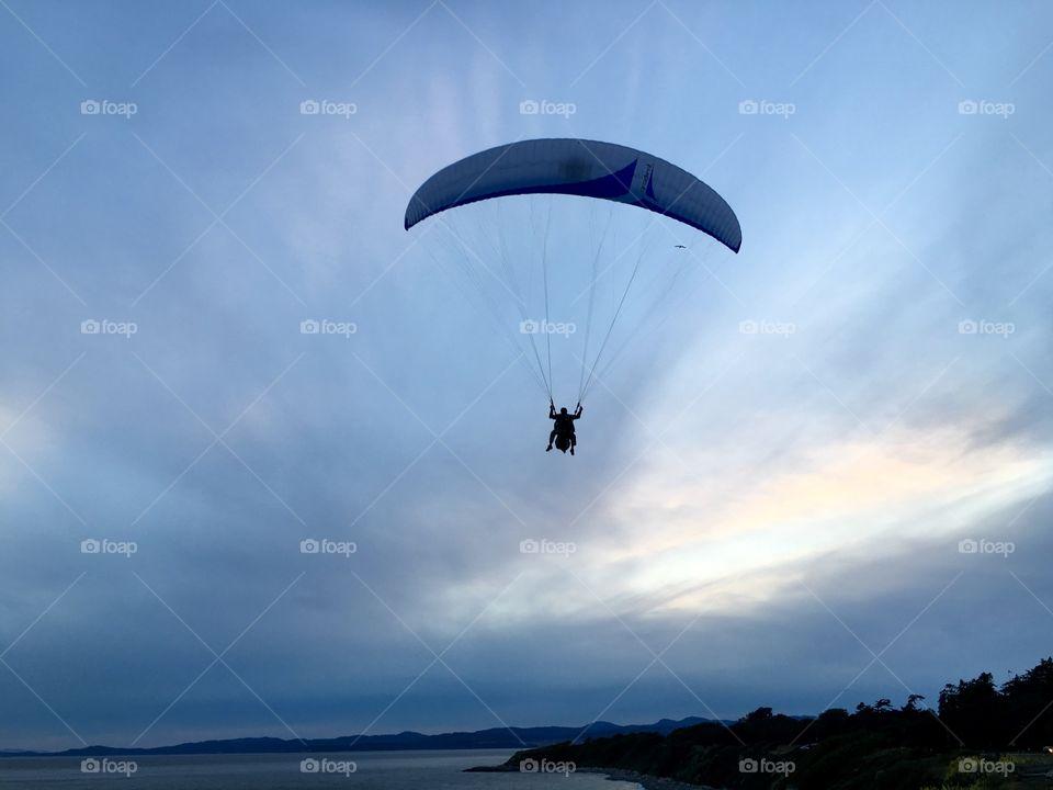 Paraglide flying over sea