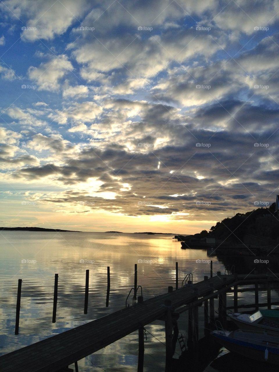 boats sky sweden sunset by lemonique