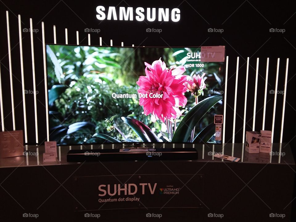 Samsung premium room featuring Quantum dot technology televisions and Dolby Atmos cinematic soundbar