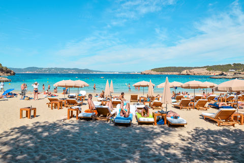 People sunbathing at cala bassa beach
