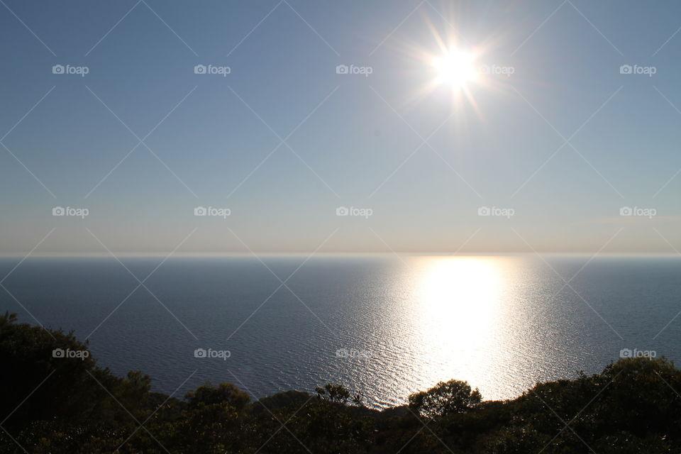 The sun over the sea.