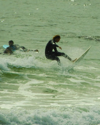 Surfers ride the waves in the Gulf of Mexico!