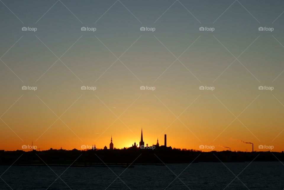 Skyline or silhouette of Tallinn, Estonia at sunset time on late December evening in 2015.