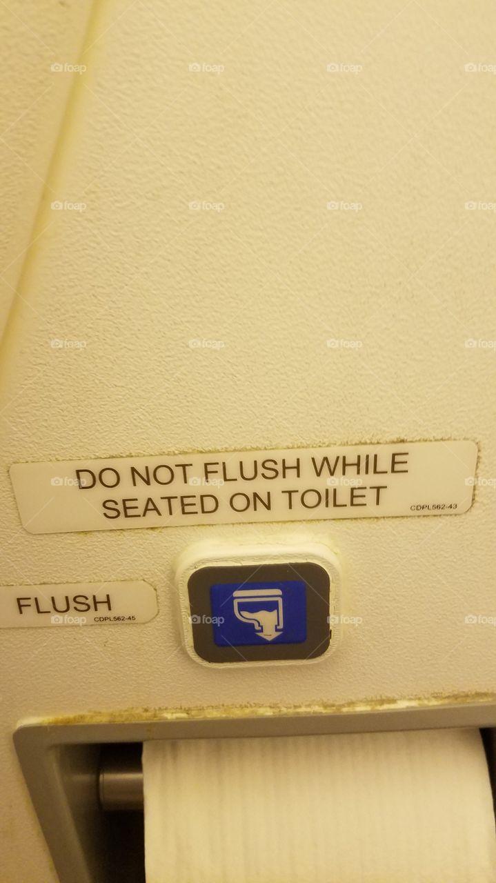 Do Not Flush Toilet on Airplane Sign