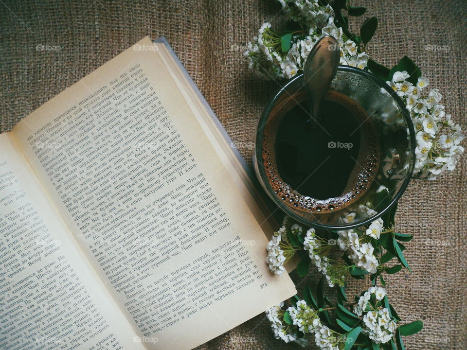 Coffee, flowers and a favorite book