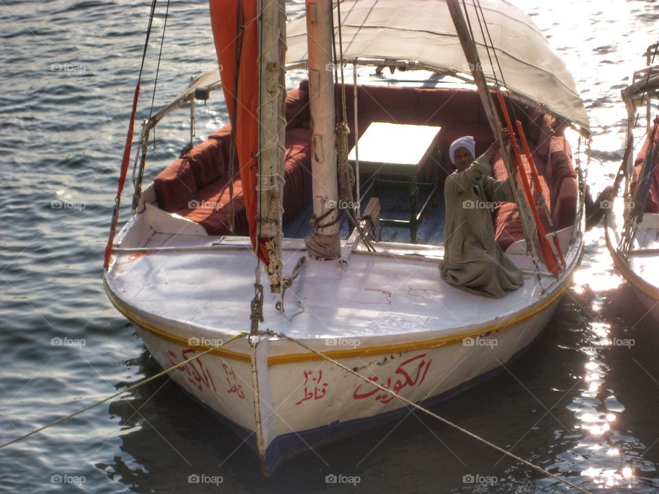 Wooden Sailing Boat. Traditional Covered Sailing Boat on the River Nile in Cairo