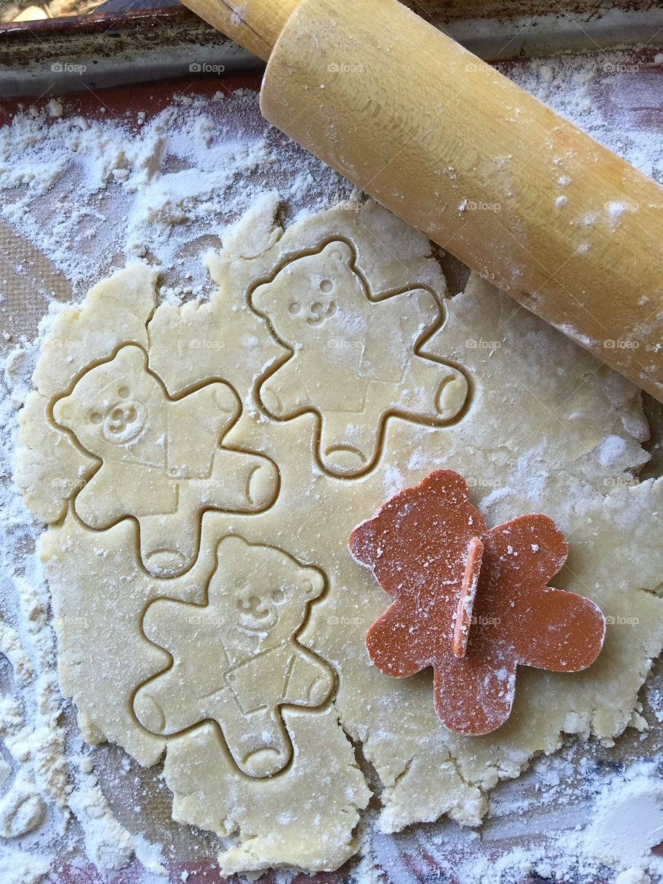 Cutting out teddy bear cookies