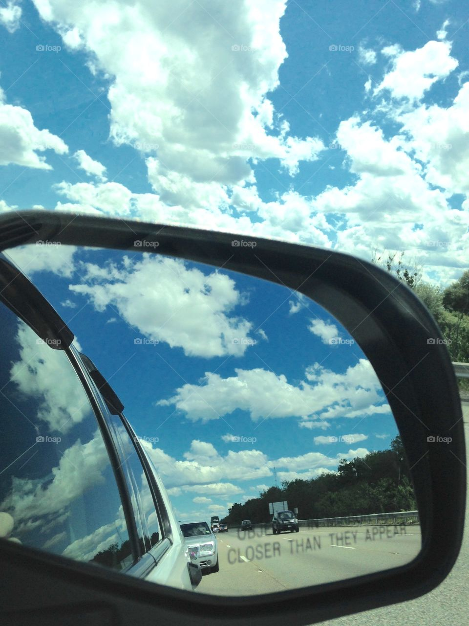 Rear View Mirror Clouds & Sky. Clouds in Rear View Mirror, Sky, Reflecting on Car. Amazing picture. Glad for my IPhone! Blue sky, white fluffy clouds.