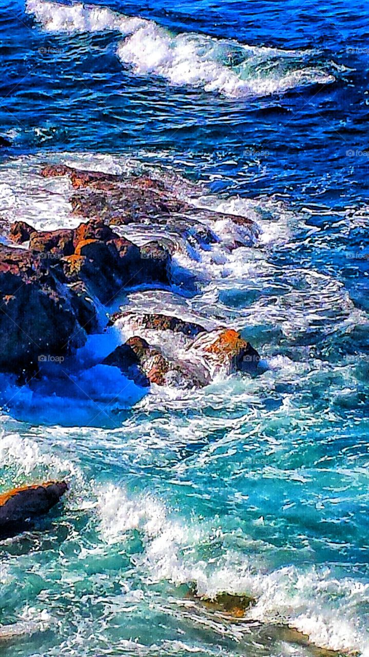 Crashing Waves. High tide at Heisler park in Laguna Beach.