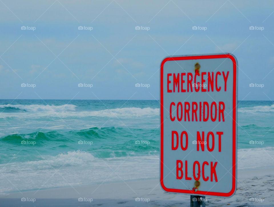 Emergency corridor do not block sign at beach