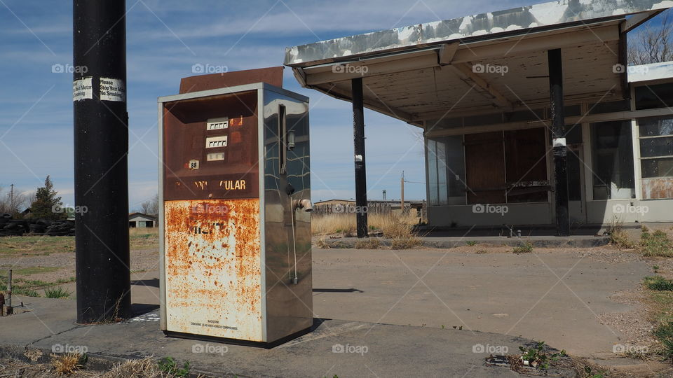 Regular Fuel gas pump. Abandoned roadside gas station with rusty old gas pump