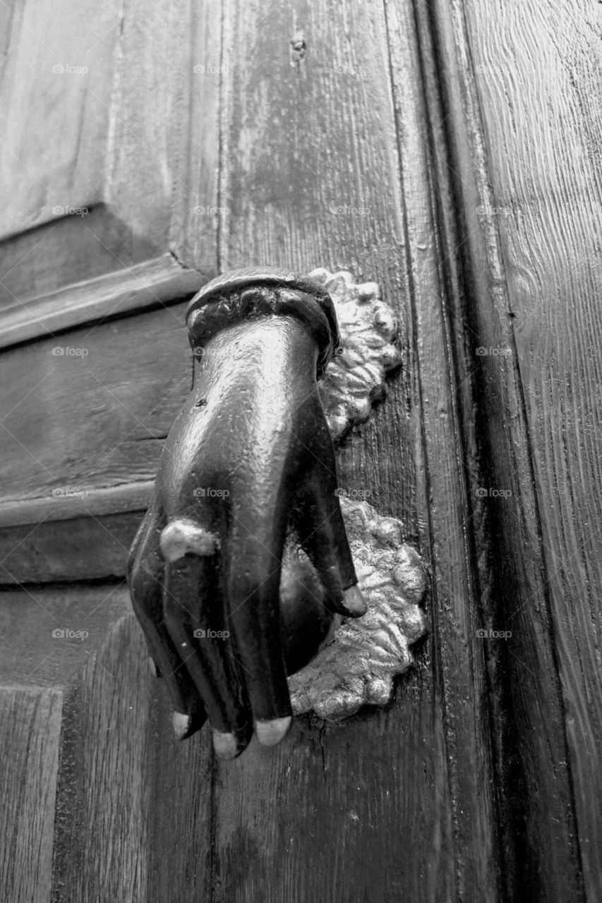 doorknocker in form of hand, black-and-white