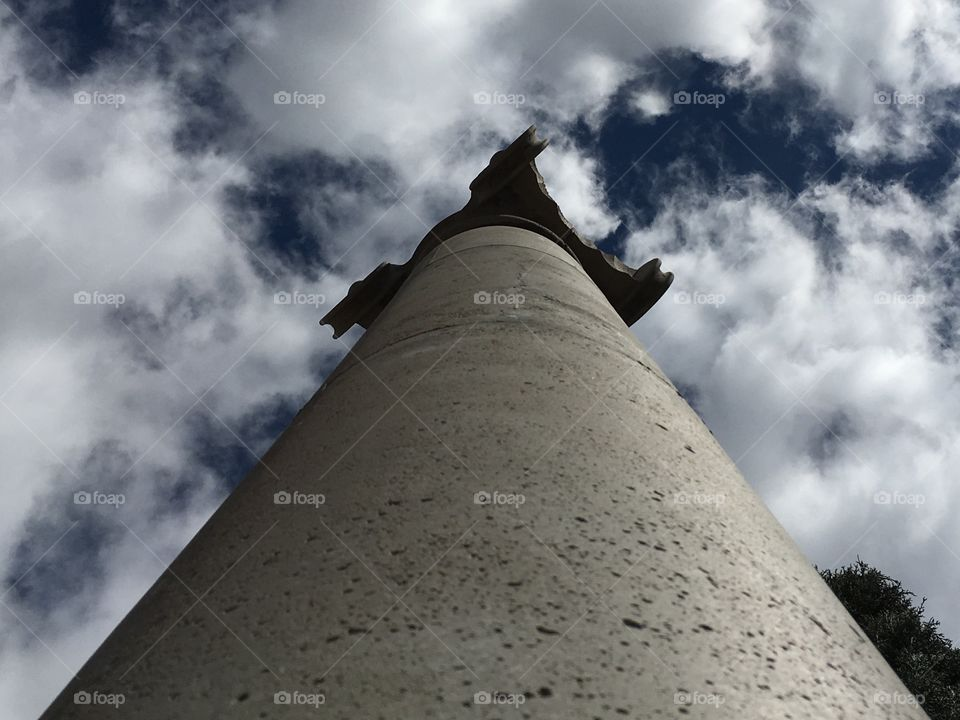 A stone pillar reaching to support the sky.