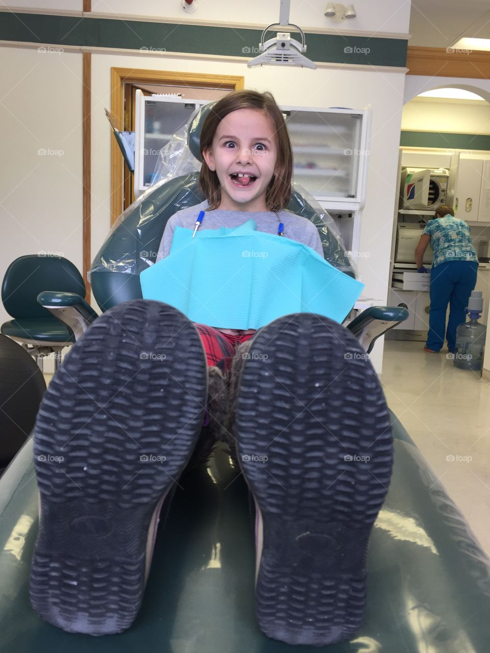 Little girl sitting on dentist chair