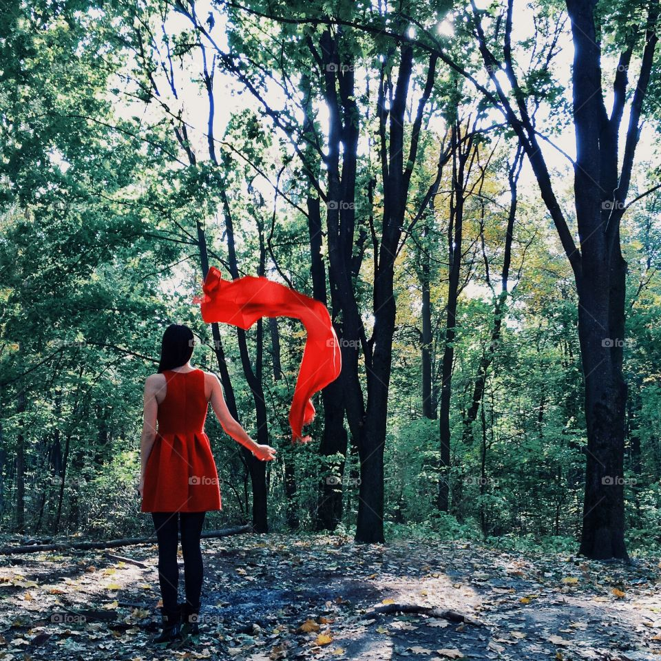 The girl with the red scarf in spring Park