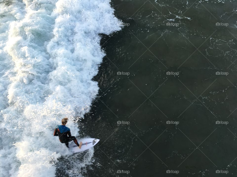 Surfer catches the wave