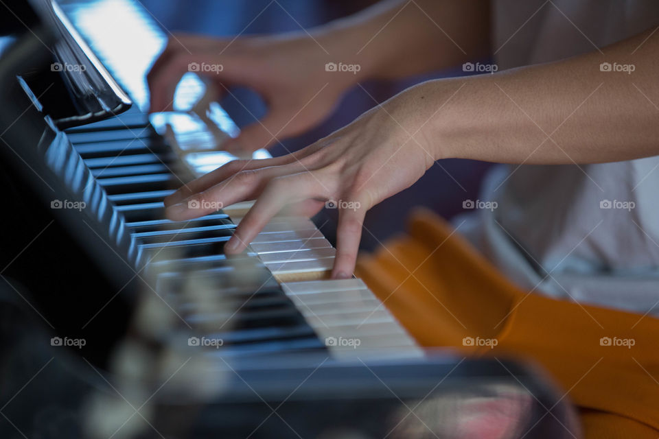 Close-up of a person playing piano