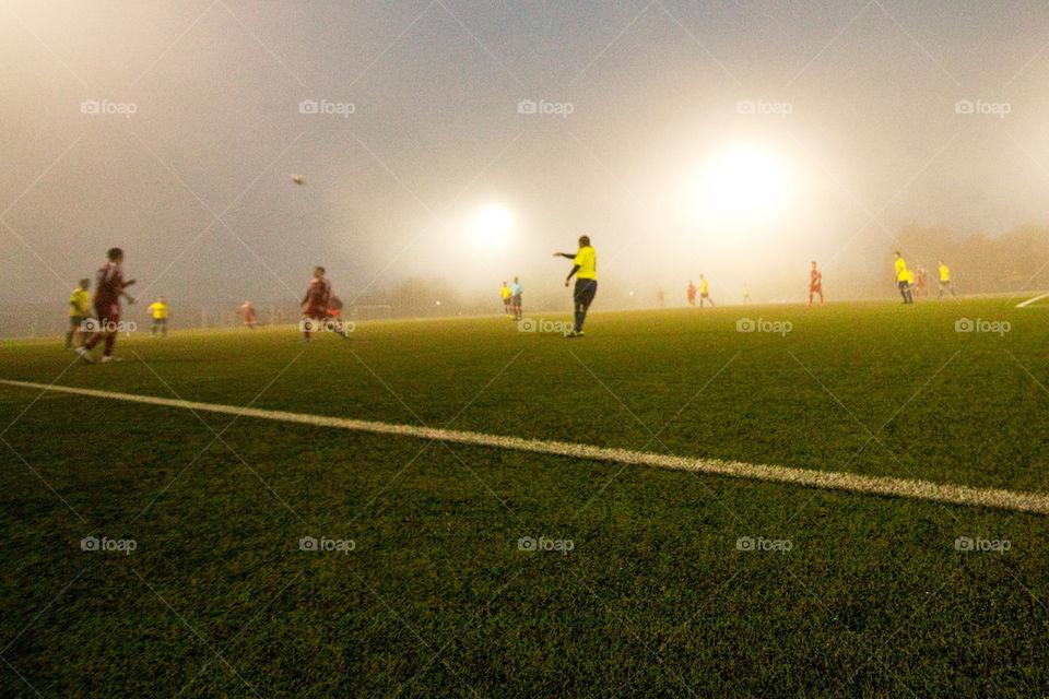 Soccer game in fog