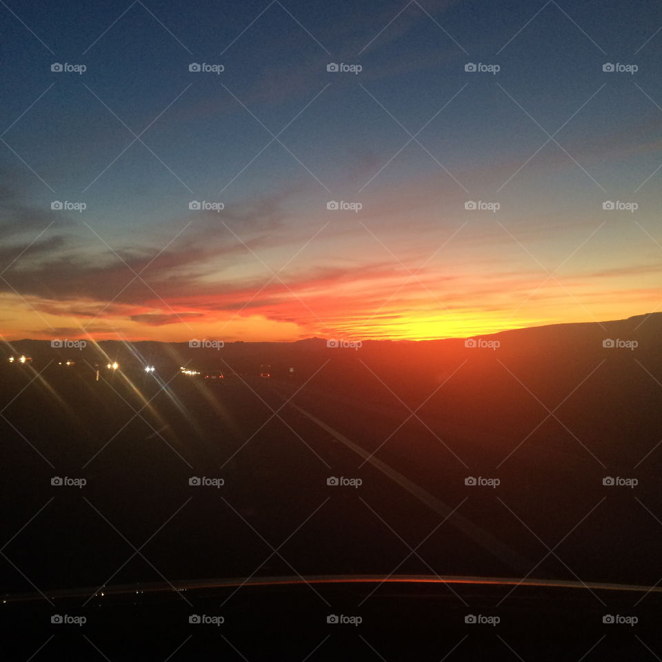 Driving Sunset. A sunset view along a highway