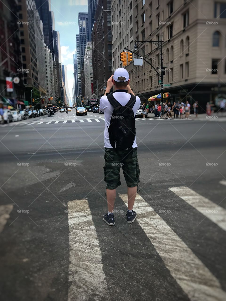 I love this image bc it puts the focus on another persons perspective rather than your own. It focuses on the man and his view of the city. The center focus is him and the view ahead of him, rather than the chaos that ensues around him.