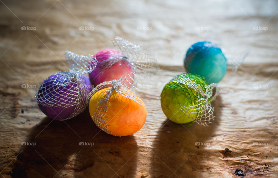 colorful Easter eggs on rustic background