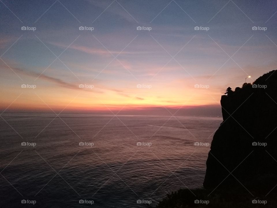 Sunset in Bali . cliffside sunset view.