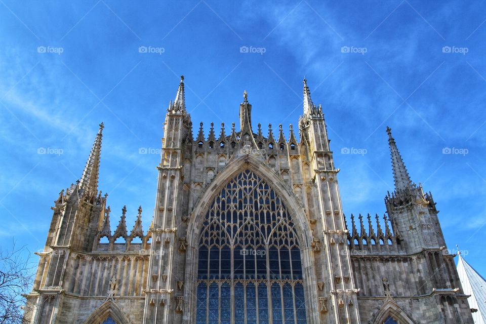 The west window of York Minster on a beautiful day. A large church.