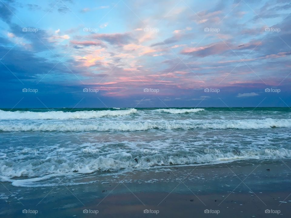 Sunset on Miami beach with waves